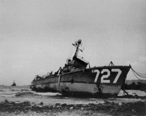 SC 727 grounded on rocks at Buckner Bay, Okinawa, 1945.